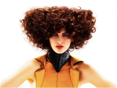 The Structured Curl  Natural curls were given maximum texture and formed using small and medium rollers; the hair was then teased into a strong angular shape to promote the broken weight line theme. Colour is INOA 5.6 and 6.42.  Tools: Denman Ice Diamond stylers to enhance and define curls.  Styling Products: Electric Smoothing Cream, LOreal Techni Art Super Dust and LOreal Professional Airfix.