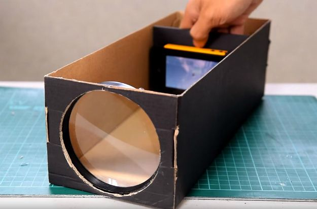 How To Make A Smartphone Projector Using A Shoebox - If you want a smartphone projector but don't want to pay an arm and a leg, this DIY tutorial will help you craft one using a shoebox and some other things. - #tech