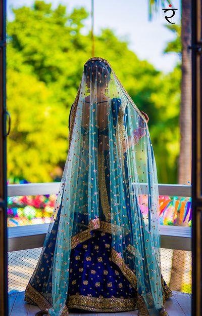Sangeet Lehengas - Indigo Blue Lehenga with Aqua Net Dupatta with Pink Detailing | WedMeGood #wedmegood #indianbride #indianwedding #blue #lehenga #bridal