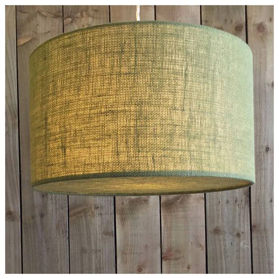 This stylish hessian lightshade & coordinating diffuser is handmade in our Bristol workshop from hessian fabric in green ▪️Fabric - green Hessian ▪️Made to order within 5 working days ▪️ Measures - Various Sizes ▪️Diffuser included. Diffusers are perfect for when shades are hung from high ceilings, they draw the eye to the shade design rather than the frame & bulbs ▪️European fitting (40mm) with a British adaptor (28mm) will fit all types of lampholder ▪️ Energy saving bulb recomm...