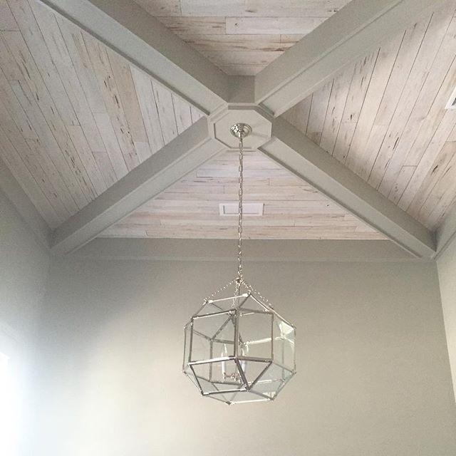 White washed pecky cypress ceiling with beams                                                                                                                                                                                 More