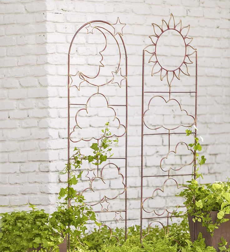 Handmade Metal Garden Trellis with Celestial Design. These would totally match the celestial theme I have going outside in my back-yard!