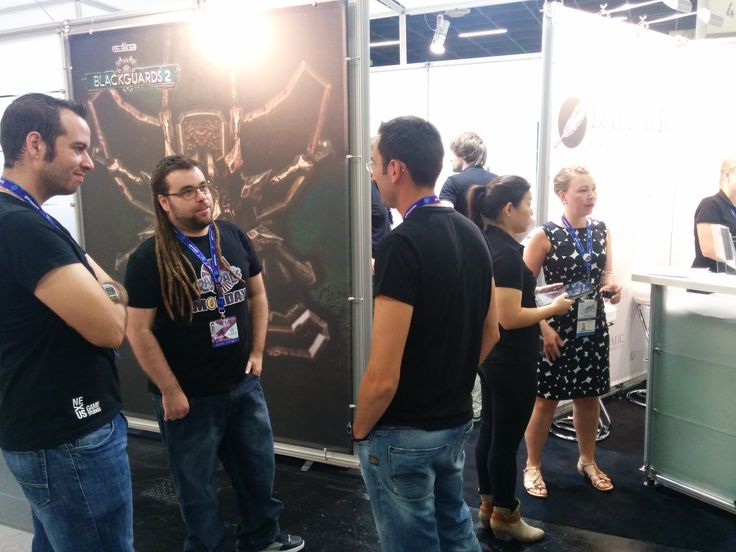 Juanan, one of Randal's Monday's devs, talking with people about the game.