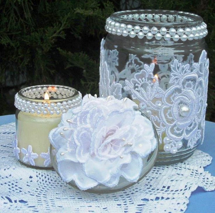 Jars covered with lace and pearls for candle holders