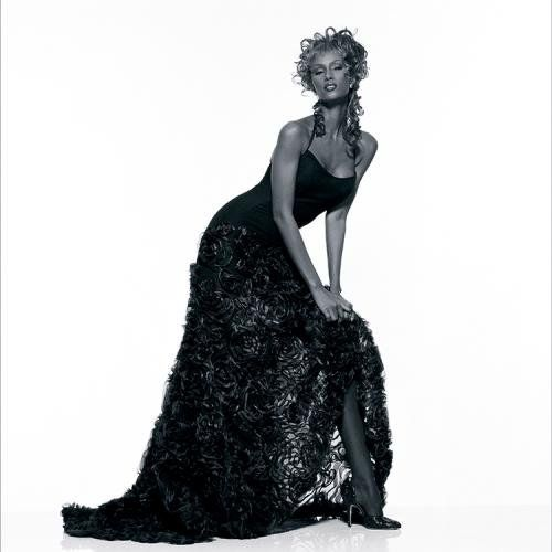 """Terry O'Neill   Iman Long Black Dress Somalian supermodel Iman wearing a long black dress, 1994.  Limited Edition Silver Gelatin Signed and Numbered  16"""" x 16"""" / 20"""" x 20""""  24"""" x 24"""" / 30"""" x 30""""  40"""" x 40"""" / 48"""" x 48""""  60"""" x 60"""" / 72"""" x 72""""  For questions or prices please contact us at info@igifa.com"""