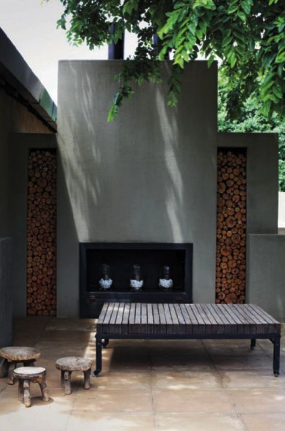 Contemporary stucco outdoor fireplace. Fire wood storage is used as accent.