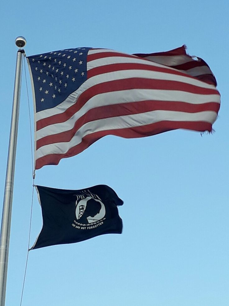 Old Glory & P.O.W. M.I.A. Flags.