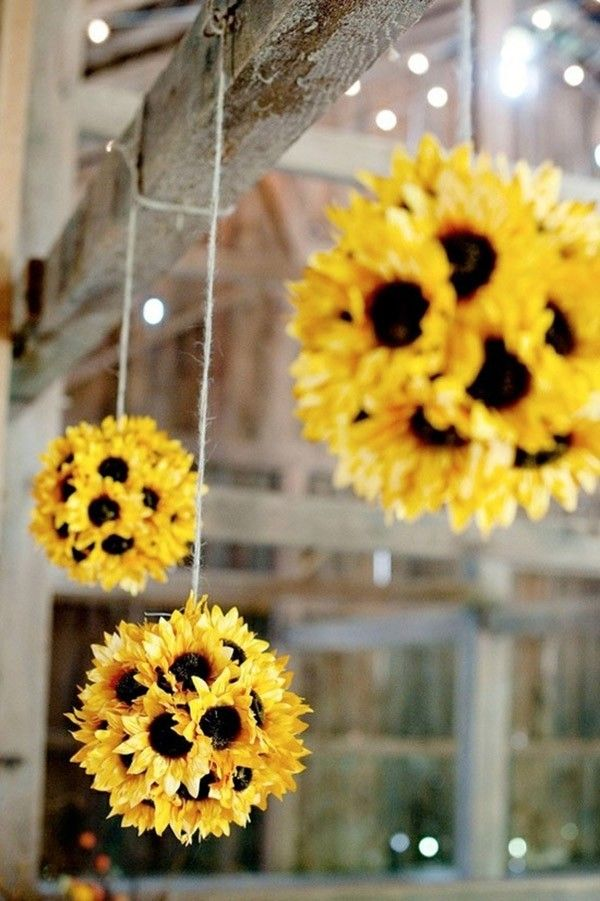 Hanging sunflower pomanders @myweddingdotcom
