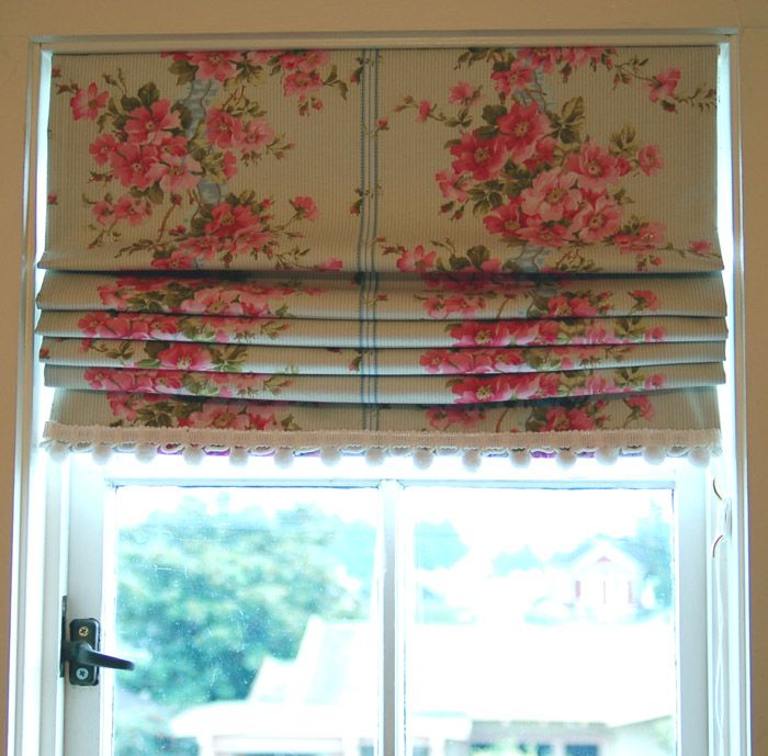 a stepped Roman blind tute but she nails it into her window frame : /
