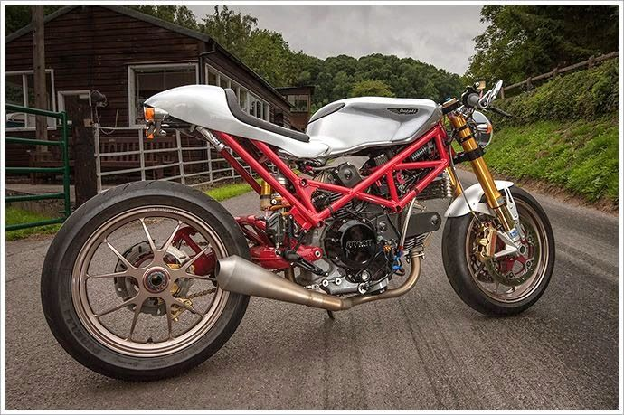 Ducati Monster SR2 Cafe Racer Ducati Cafe Racer based on Ducati Monster SR2 built by mechanical engineer John Grainge. Custom Cafe racer seat by Radical Ducati,  sub-frame was rebuilt, Custom fuel tank mounting and rear set was machined by john. Fuel tank was borroed from Ducati 749 and customized, Ohlins front suspension and disc brakes from Ducati 848, Ohlins rear suspension from Ducati 999, Ducati Hypermotard 1100S Marchesini magnesium wheels, Harley-Davidson V-Rod headlamp, Custom ...