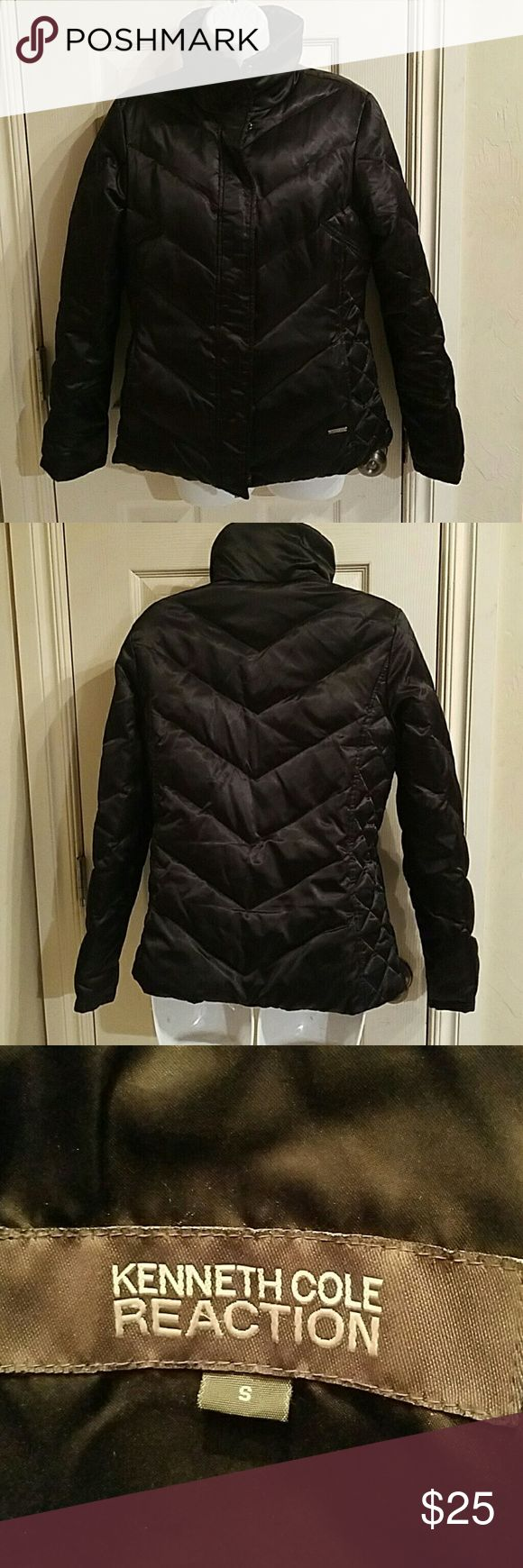 KENNETH COLE REACTION,  LADIES DOWN JACKET Ladies black Kenneth Cole Reaction black  quilted jacket with side pockets with zip and snap closures in excellent condition with no flaws size small. It's machine washable the outer shell is 100% polyester and the lining it's filled with 60% goose down and 40% feathers. Measurements upon request this item is from a clean non-smoking home. Thank you for looking Kenneth Cole Reaction Jackets & Coats