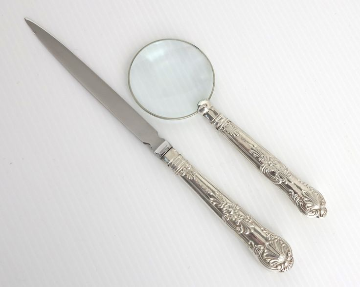 Antique sterling silver handled magnifying glass and letter opener, elaborate…