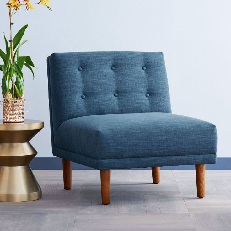 Rounded Retro Armless Chair - perfect to fit into a small space without over empowering the room. Great mid-century blue too!