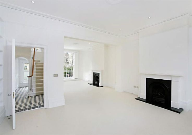Listed period home that extended and refurbished in St Johns Wood, London. This is the expansive living space before furniture was put it.