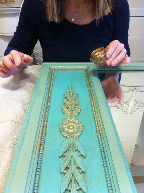 Maison Decor: Turquoise and Gold Inspiration! I painted the entire thing with this turquoise blue. Then I added a watery layer of Versailles over the blue, except in the paneled area of the Trumeau. After that, I applied clear and dark to the entire mirror frame. Then used rubbing gold.
