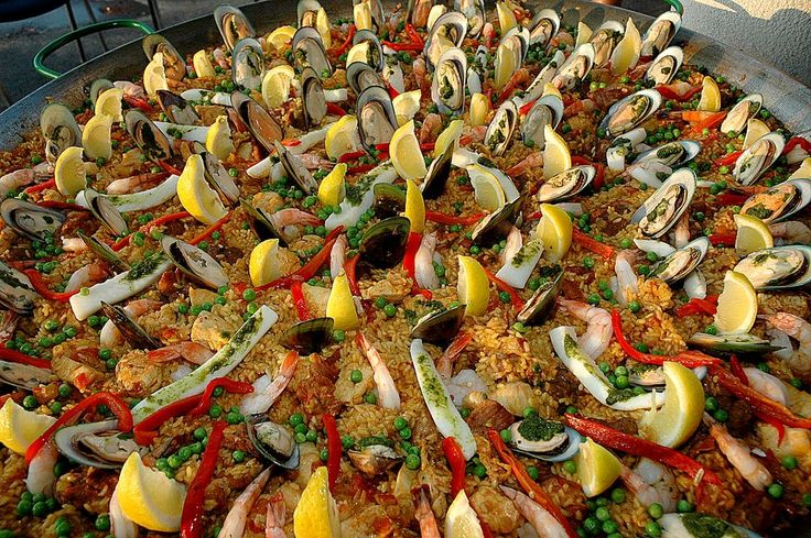 Paella! Pair with a red Rioja, a Tempranillo, or a nice Grenach