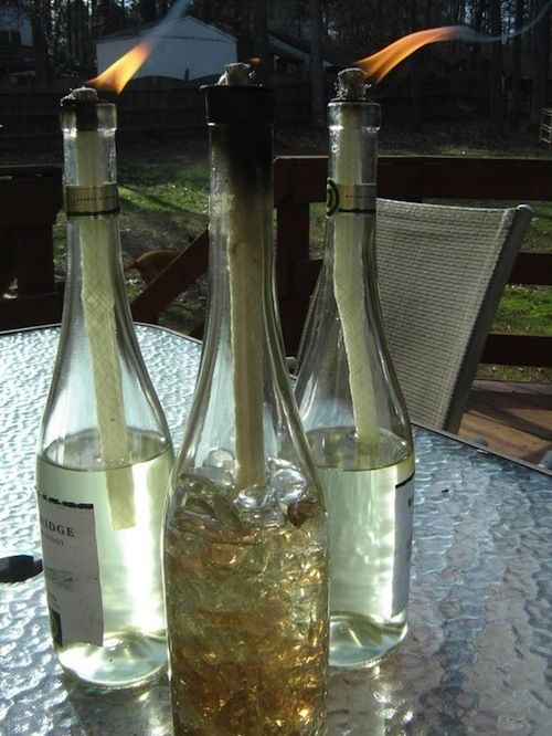 Reuse empty wine bottles by making mosquito repelling tiki torches with them. Fill the bottles with citronella oil. Full Instructions: http://www.whenthepigsfly.com/2012/01/diy-wine-bottle-torches.html