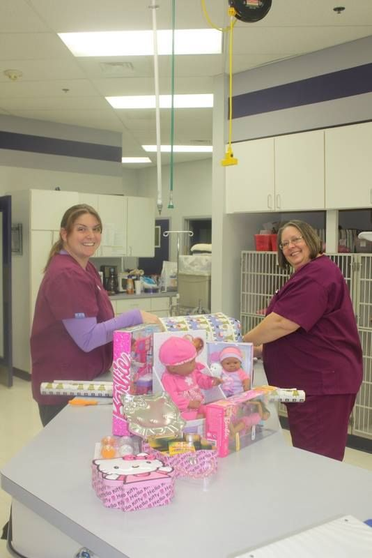 Melissa and Ranee, two of our Registered Veterinary Technicians, wrapping Christmas presents. #Animal Hospital #Veterinarian #Pets #Vet #KAH #FrederickMaryland #Christmas #GivingBack