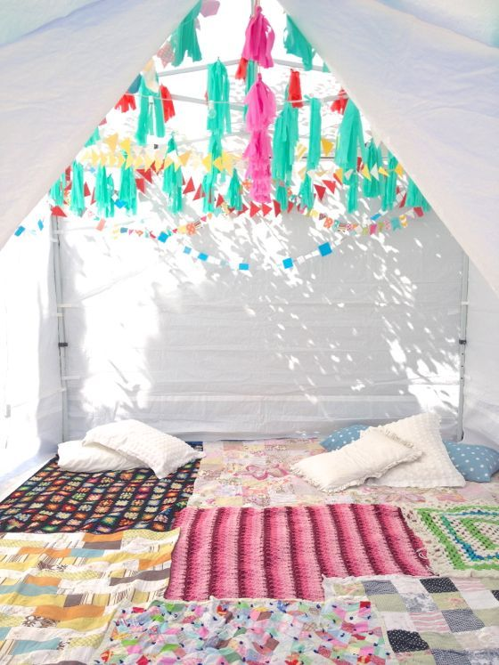 slumber party tent with quilts on the floor