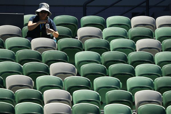 Marta Kostyuk Photos - A spectator sits in the sun at Rod Laver Arena during the third round match between Marta Kostyuk of Ukraine and Elina Svitolina of Ukraine on day five of the 2018 Australian Open at Melbourne Park on January 19, 2018 in Melbourne, Australia. - 2018 Australian Open - Day 5