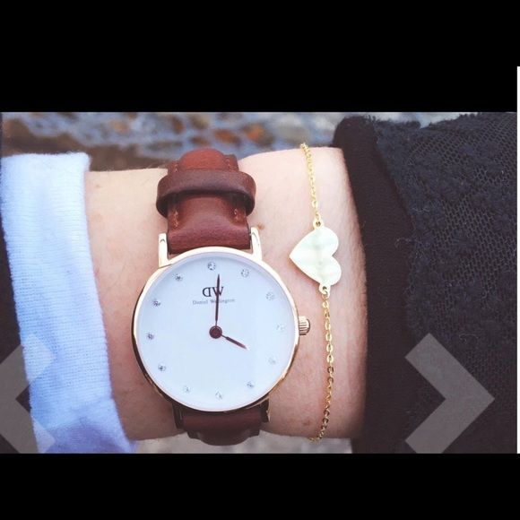 Daniel Wellington watch Brand new inspired Daniel Wellington watch . Classic Sheffield brown strap with gold face . 40mm diameter , water resistant . No trades only serious buyer , top quality watches and fast shipping . Great price :) Daniel Wellington Accessories Watches
