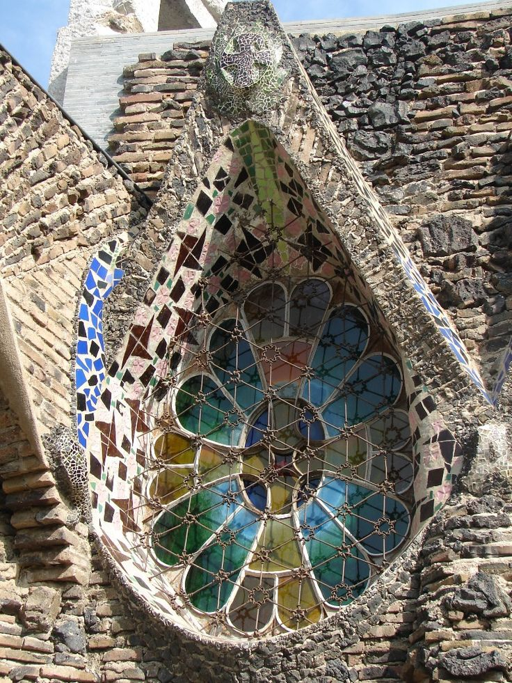 Window on the Gaudi Colonia Guell Crypt.  The Church of Colonia Guell is an unfinished work by Antoni Gaudi.  It was built as a place of worship for the people in a manufacturing suburb in Santa Coloma de Cervello, near Barcelona, Spain.  Photo: google.search.com