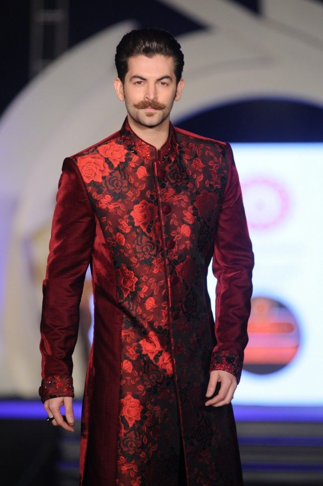 Neil Nitin Mukesh in burgundy red floral sherwani by Rohit Verma. More photos - http://www.indianweddingsite.com/marigold-watches-rohit-verma-fashion-show/