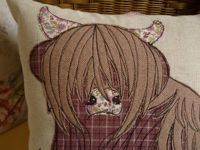 Highland Cow raw edge applique free motion machine embroidery cushion. Vintage tweeds and wool fabrics on linen. A commission by Julie Filmer from The Peacock Emporium More