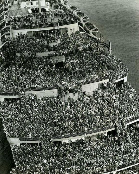 "The liner ""Queen Elizabeth"" bringing American troops into NY Harbor at the end of WWII 1945."