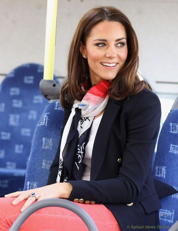 Dress casual look with navy blazer, scarf, and coral-colored denim jeans. From What Kate Wore.