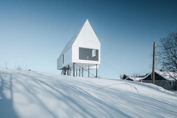 Stilts elevate this small winter cabin by Delordinaire above a snow-laden slope in Quebec