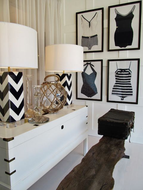 Pretty chevron lamps (chevron looks great on flat linear surface) and those framed antique swimsuits are to die for!