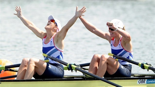 Katherine Grainger and Anna Watkins of Great Britain celebrate after winning gold in the Women's Double Sculls final on Day 7 of the London 2012 Olympic Games at Eton Dorney