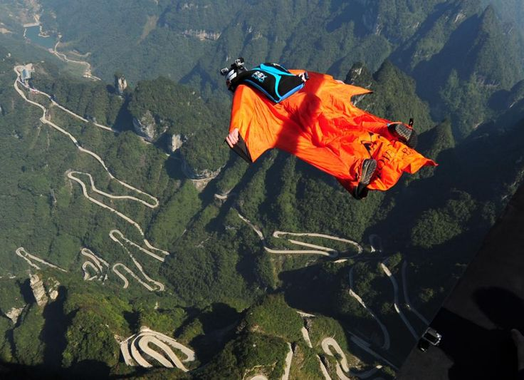 A participant in wingsuit flies above Tianmen Mountain at Zhangjiajie Scenic Spot during the 4th Red Bull WWL China Grand Prix on Oct. 16, 2015 in Zhangjiajie, Hunan Province of China. The 4th Red Bull WWL China Grand Prix will last three days from October 16-18 in Zhangjiajie. (ChinaFotoPress/Getty Images)