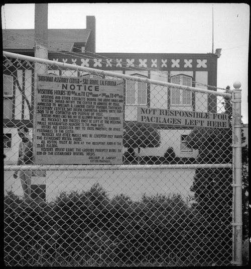 San Bruno, California. A sign at the main entrance of the Tanforan Assembly center, through which all traffic passes. The gate is guarded and controlled by United States soldiers.