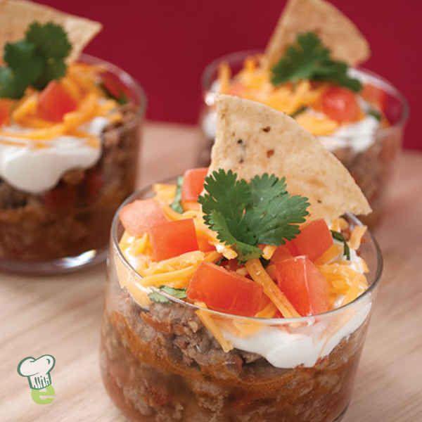 Taco Dip: For your next party, try this tasty taco dip. This easy appetizer is the perfect party food. It's simple and quick, so you can spend more time with your guests.