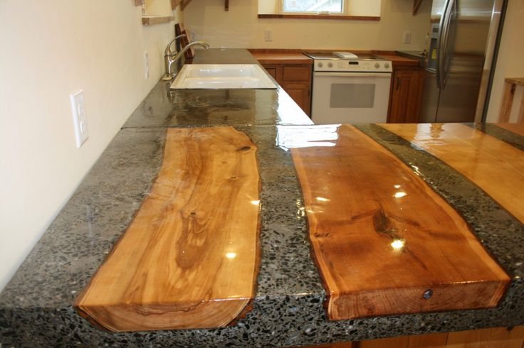 I'm definitely doing this in mine! Wood set into the concrete for built in cutting boards. Genius!