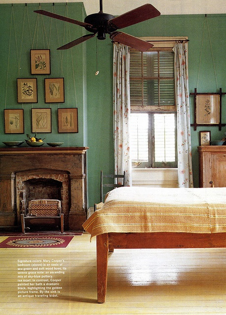 love the green, but also the difference in woods of bed and mantle, brick surround and buttery yellows   Mary Cooper's New Orleans Creole cottage.