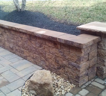 How to build a cinder concrete block retaining wall for Block wall landscape design