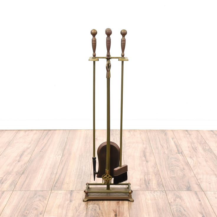This fireplace poker set is featured in a solid brass with an antiqued finish. This American traditional style fireplace tool set has a poker, brush, and shovel. Perfect for any fireplace! #americantraditional #decor #decorativeaccents #sandiegovintage #vintagefurniture