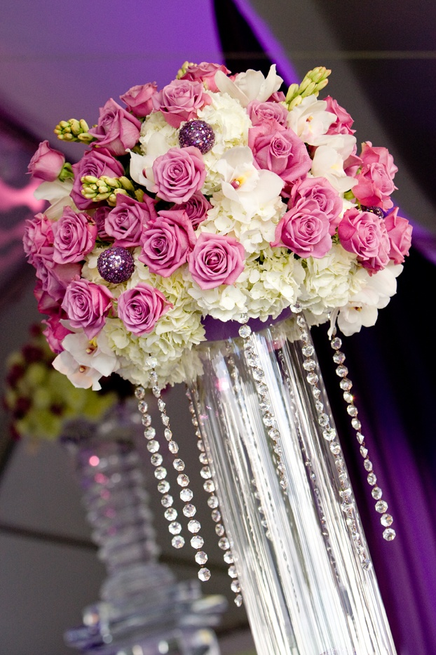 Towering centerpiece with chandelier strands photo by