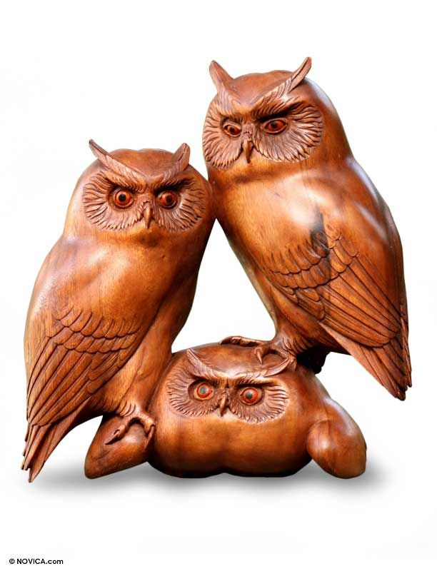 Wood sculpture owl and her chicks carving owls