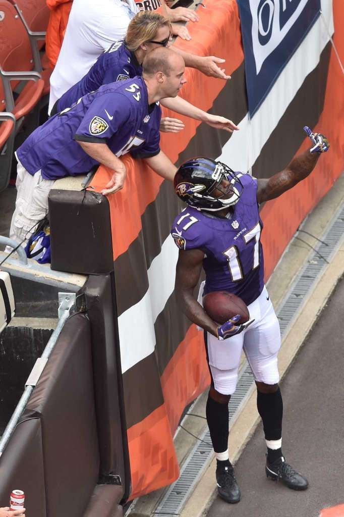 Baltimore Ravens wide receiver Mike Wallace (17) pretends to take a selfie with…