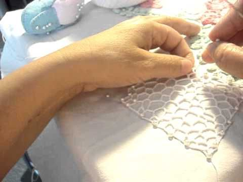 Irish Lace crochet - watch a lady on YouTube do the netting that connects the motifs.