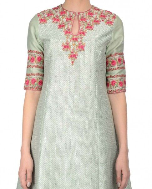 Mint green anarkali style kurta with floral prints all over adorning the inner slip. This set also includes matching overlay with chevron prints featuring floral thread embroidery at yoke and elbow sleeves. Round key hole neckline. Wash Care: Dry clean onlyMatching churidar leggings and dupatta included