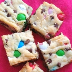 An easy recipe for loaded sugar cookie bars stuffed with candy and