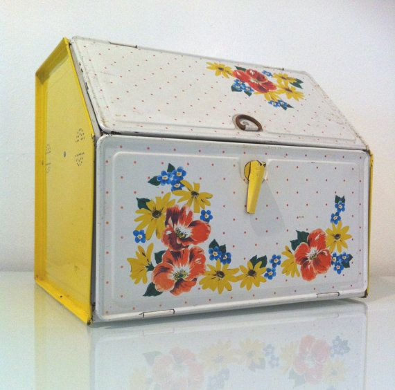 I use Vintage Bread Boxes for snacks, spices, medicine, etc. I have three of these in different styles because they cutely hide lots o'clutter.