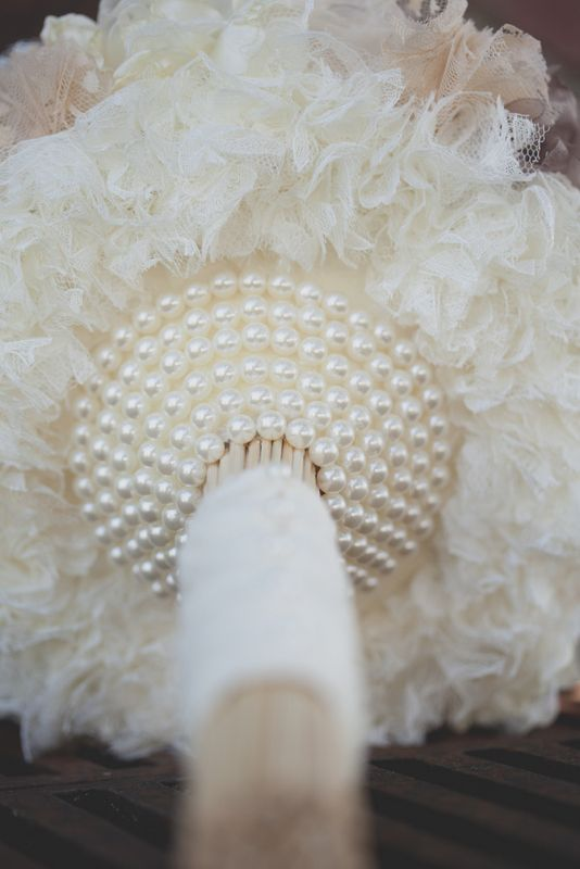 Custom fabric flower bridal bouquet for a vintage wedding, with pearl draping under side.