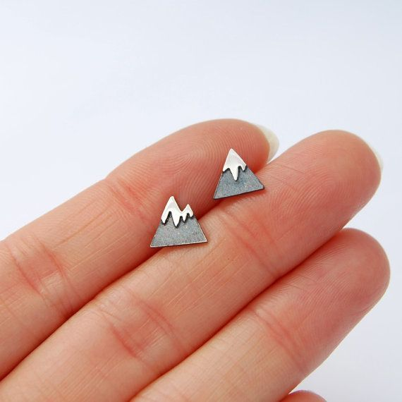 Tiny mountain studs handmade in sterling silver. Oxidized sterling silver with a contrasted shiny (or brushed) snow cap. The blackened section will slightly rud off over time and wear and get a unique patina, to keep it darker longer I recommend taking the earrings off to shower and sleep. Perfect gift for the nature lover or your for favorite hiker. :)  About 7/16 X 7/16 each.