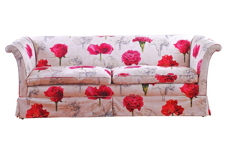 Upholstered floral sofa with bright pink flowers on a for Chintz couch